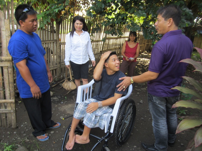Wheel chair for Isagani Feleciano 18 years old receives his first wheel chair